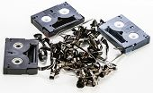 Broken video tapes in a pile on white