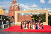 MOSCOW - JUN 23: Graduates are photographed in front of big frame on Sapozhkovaya Square near the Kr