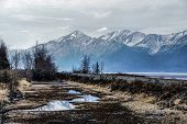 Misty Alaskan Mountains. Train Tracks Following the Turnagain Arm.
