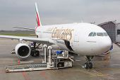 WARSAW, POLAND - MARCH 24: Emirates Airbus A330 plane at Chopin Airport on March 24, 2014 in Warsaw,