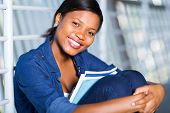 attractive african american woman with books