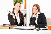 Two Young And Pretty Businesswomen Working