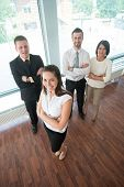Smiling woman shot from above in corporate environment