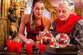 stock photo of palm-reading  - Female Fortuneteller or esoteric Oracle - JPG