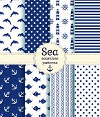 image of dolphins  - Set of sea and nautical seamless patterns in white and dark blue colors - JPG