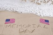stock photo of memorial  - Memorial day background on the sandy beach near ocean - JPG