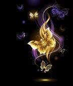 image of brooch  - artistically painted gold jewelry butterfly on abstract dark background - JPG