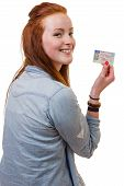 Young Woman Showing Her Driver's License