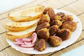 lula kebab with croutons and pickled onions