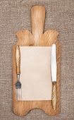 Old Kitchen Board With Aged Paper, Fork And Knife