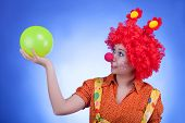 Fun Woman Clown On Blue Background