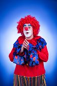 Smiling Clown On Blue Background Studio Shooting