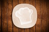 Colorful plate with hand drawn white chef symbol on grungy background