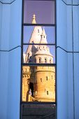 Windows Reflection Of Fisherman's Bastion Lit By Sunset