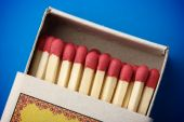 pic of conscript  - Red matchsticks in the box on blue background shallow DOF - JPG