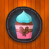 vector cupcake with chocolate and mint cream.