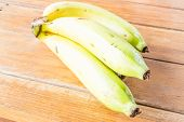 Fresh Bunch Of Bananas On Wooden Table