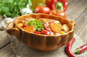 picture of saucepan  - Meat stewed with vegetables in the saucepan - JPG