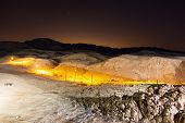 stock photo of billion  - Night landscape of desert mountains near Dead Sea with a lot of star in the sky - JPG