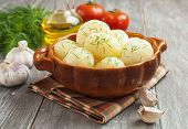 stock photo of saucepan  - Potatoes with dill in a saucepan on the table - JPG
