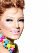 Beauty Girl Portrait with fashion hairstyle, Colorful Makeup and Accessories. Studio Shot of Beautif