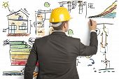 stock photo of efficiencies  - Engineer that calculates the energy efficiency of a house - JPG