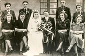 LODZ, POLAND, CIRCA 1940's: Vintage photo of newlyweds posing with their family and guests