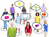 Cheerful Multi-Ethnic Group Of People Standing Individually Above Them Speech Bubbles With Symbols Of Social Networking Inside.
