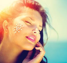 stock photo of body-lotion  - Suntan Lotion Woman Applying Sunscreen Solar Cream - JPG