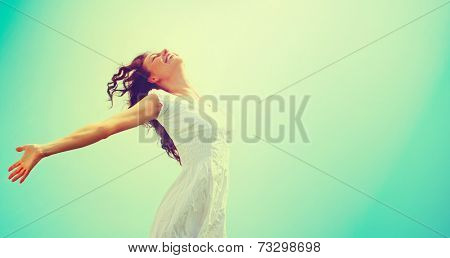 Free Happy Woman Enjoying Nature. Beauty Girl Outdoor. Freedom concept. Beauty Healthy Girl over Sky