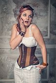picture of minx  - Beautiful steampunk woman with pink hair surprised - JPG