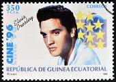 EQUATORIAL GUINEA - CIRCA 1996: A Stamp printed in Guinea dedicated to cinema shows Elvis Presley