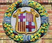 Famous ceramic decoration in Plaza de Espana Sevilla Spain. Coat of Barcelona.