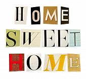 The phrase Home Sweet Home formed with magazine letters on white background