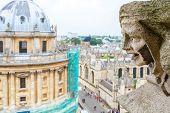 image of church-of-england  - Carved Gargoyle Figure and Radcliffe Camera from St - JPG