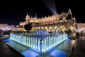 Fountain And Cloth Hall In Krakow, Poland