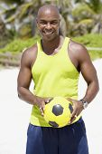 African American man holding soccer ball