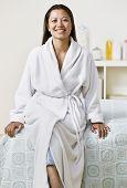 Asian woman wearing bathrobe