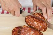 Butcher Slicing A Spanish Sausage Called Morcon