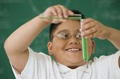 Hispanic boy in science class