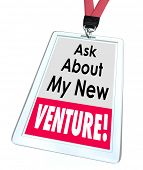 Ask About My New Venture words on a badge or name tag to illustrate a business startup or enterprise