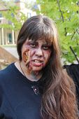 MUSKOGEE, OK - Sept. 13: With fresh makeup, zombie waits for runners to attack during the Castle Zombie Run at the Castle of Muskogee in Muskogee, OK on September 13, 2014.