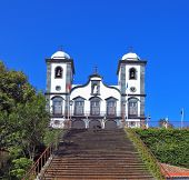 To the magnificent white church  the long picturesque ladder conducts. Sights of the Portuguese island of Madeira