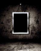 Photo frame on grunge wall