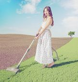 Young woman cleaning natural green grass  in wild  landscape. Creative concept photo combination
