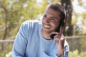 Native American man talking on cell phone