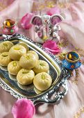 Indian sweets with tiny statue of Ganesha.