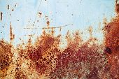 foto of scrap-iron  - Old blue grunge metal wall with red rust background texture - JPG