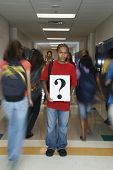 African American teenaged student holding question mark sign