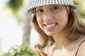 Hispanic woman wearing hat